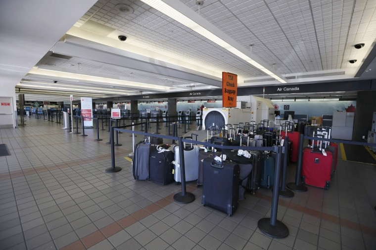Luggage sit unattended in terminal 3 after a shooting incident at Los Angeles airport (LAX), California November 1, 2013. (Lucy Nicholson/Reuters)