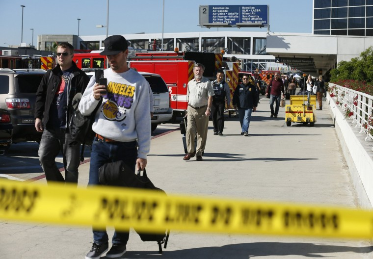 Passengers evacuate after a shooting incident at Los Angeles airport (LAX), California November 1, 2013. (Lucy Nicholson/Reuters)
