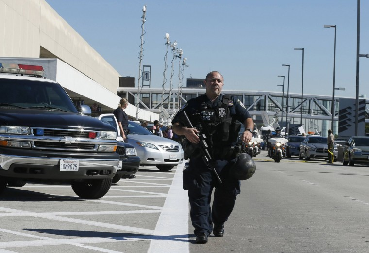 An airport police officer walks towards terminal 3 after a shooting incident at Los Angeles airport (LAX), California November 1, 2013. (Lucy Nicholson/Reuters)