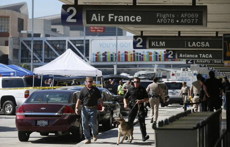 Police walk outside terminal 2 after a shooting incident at Los Angeles airport (LAX), California November 1, 2013. (Lucy Nicholson/Reuters)