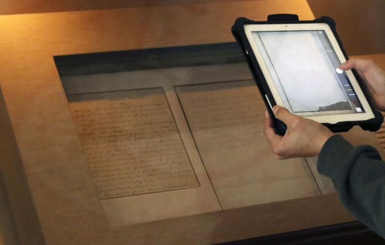 "A student photographs the Nicolay copy of U.S. President Abraham Lincoln's Gettysburg Address speech at the Library of Congress in Washington November 11, 2013. On November 19, 2013, it will be 150 years since the Gettysburg Address was delivered to a crowd of about 15,000 spectators by Massachusetts orator Edward Everett. Officially, Lincoln's two-minute speech was labelled ""remarks"" and yet it has stood the test of time and will be recited at commemoration ceremonies at Soldier's National Cemetery in Gettysburg on Tuesday. Picture taken November 11, 2013. (Gary Cameron/REUTERS)"