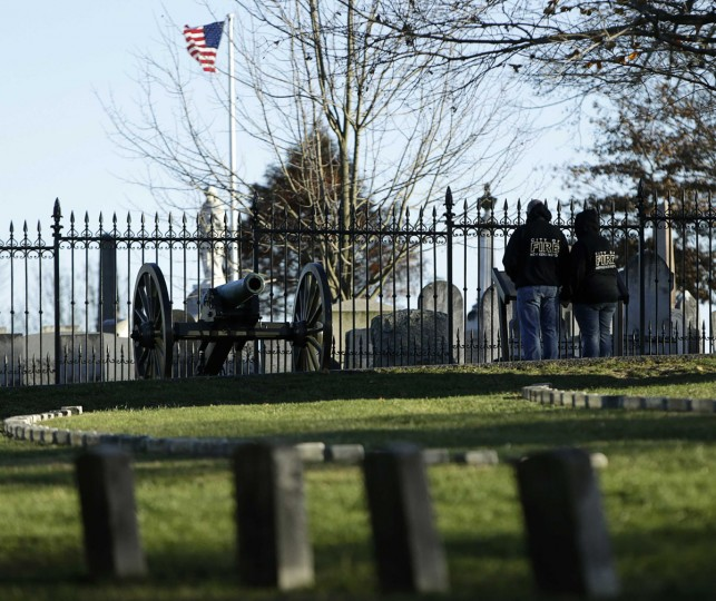 Visitors look at graves at the Gettysburg National Cemetery in Pennsylvania November 18, 2013. The site is the burial ground for Civil War Union soldiers, where U.S. President Abraham Lincoln travelled to in 1863 to deliver a few concluding remarks at a formal dedication. Tuesday marks the 150th anniversary of Lincoln's famous Gettysburg Address. (Gary Cameron/REUTERS)