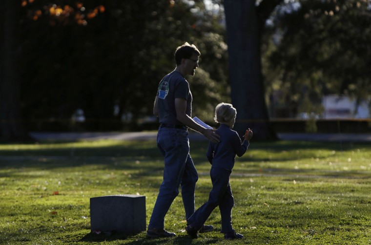 A man and his son search for names at the Gettysburg National Cemetery in Pennsylvania November 18, 2013. The site is the burial ground for Civil War Union soldiers, where U.S. President Abraham Lincoln travelled to in 1863 to deliver a few concluding remarks at a formal dedication. Tuesday marks the 150th anniversary of Lincoln's famous Gettysburg Address. (Gary Cameron/REUTERS)