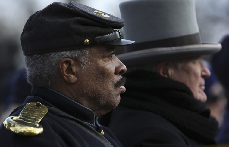 A re-enactor, portraying a member of the U.S. Colored Troops, a black regiment of African-American soldiers during the U.S. Civil War, listens to speeches at the Gettysburg National Cemetery in Pennsylvania November 19, 2013. U.S. President Abraham Lincoln travelled to in 1863 to deliver a few concluding remarks at a formal dedication at the cemetery. Today marks the 150th anniversary of Lincoln's famous two-minute speech, the Gettysburg Address. (Gary Cameron/REUTERS)