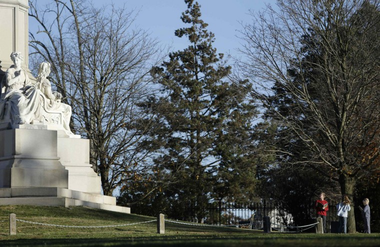 Children look at a statue at the Gettysburg National Cemetery in Pennsylvania November 18, 2013. The site is the burial ground for Civil War Union soldiers, where U.S. President Abraham Lincoln travelled to in 1863 to deliver a few concluding remarks at a formal dedication. Tuesday marks the 150th anniversary of Lincoln's famous Gettysburg Address. (Gary Cameron/REUTERS)