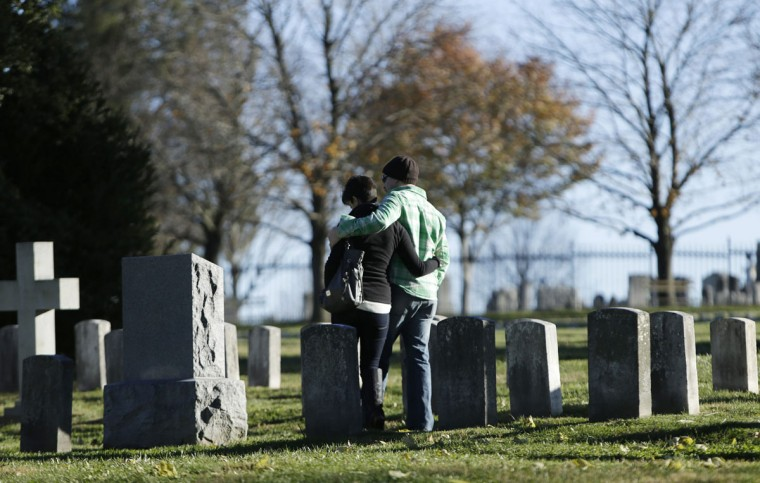 Visitors stand amongst graves at the Gettysburg National Cemetery in Pennsylvania November 18, 2013. The site is the burial ground for Civil War Union soldiers, where U.S. President Abraham Lincoln traveled to in 1863 to deliver a few concluding remarks at a formal dedication. Tuesday marks the 150th anniversary of Lincoln's famous Gettysburg Address. (Gary Cameron/REUTERS)