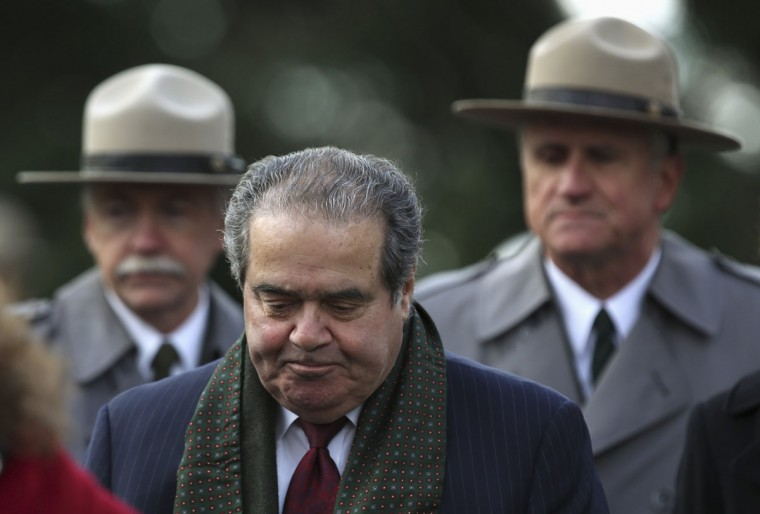 U.S. Supreme Court Justice Antonin Scalia (C) arrives at the Gettysburg National Cemetery in Pennsylvania November 19, 2013, the burial ground for Civil War Union soldiers in which U.S. President Abraham Lincoln travelled to in 1863 to deliver a few concluding remarks at a formal dedication. Today marks the 150th anniversary of Lincoln's famous two-minute speech, the Gettysburg Address. (Gary Cameron/REUTERS)