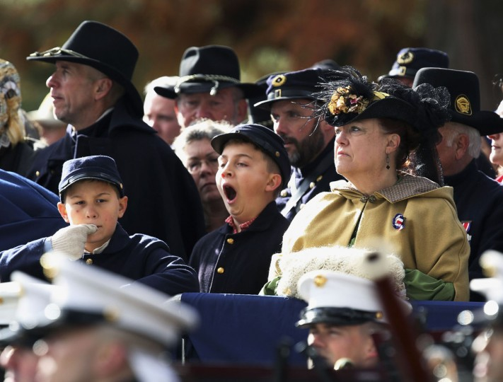 A young Union Civil War re-enactor (C) yawns at the Gettysburg National Cemetery in Pennsylvania November 19, 2013, the burial ground for Civil War Union soldiers in which U.S. President Abraham Lincoln travelled to in 1863 to deliver a few concluding remarks at a formal dedication. Today marks the 150th anniversary of Lincoln's famous two-minute speech, the Gettysburg Address. Gary Cameron/REUTERS)