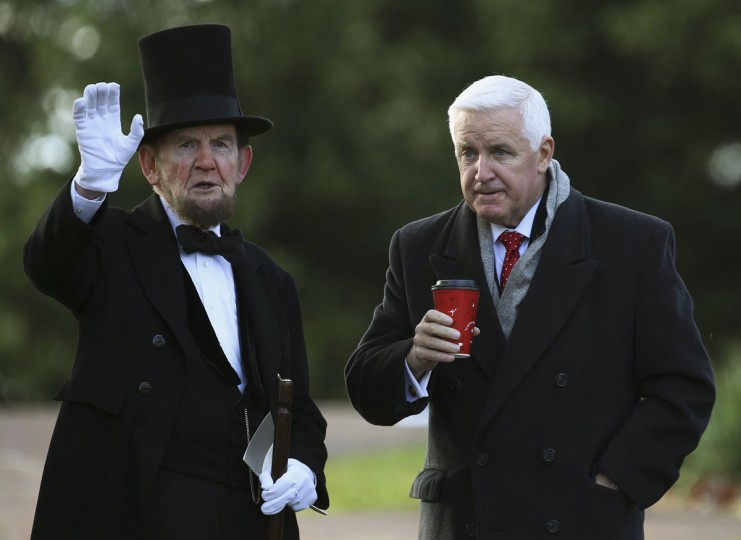 James Getty (L), portraying U.S. President Abraham Lincoln, chats with Pennsylvania Republican Governor Tom Corbett (R) before delivering the Gettysburg Address at the Gettysburg National Cemetery in Pennsylvania November 19, 2013. Lincoln travelled to Gettysburg in 1863 to deliver a few concluding remarks at a formal dedication. Today marks the 150th anniversary of Lincoln's famous two-minute speech. (Gary Cameron/REUTERS)