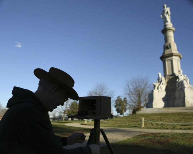 Kevin Gallagher of Butler, Pennsylvania, takes a photograph at the Gettysburg National Cemetery in Pennsylvania November 18, 2013. The site is the burial ground for Civil War Union soldiers, where U.S. President Abraham Lincoln travelled to in 1863 to deliver a few concluding remarks at a formal dedication. Tuesday marks the 150th anniversary of Lincoln's famous Gettysburg Address. (Gary Cameron/REUTERS)