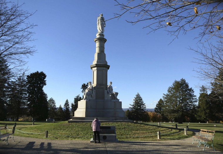 A woman reads a memorial at the spot where U.S. President Abraham Lincoln delivered his Gettysburg Address at the Gettysburg National Cemetery in Pennsylvania November 18, 2013. The site is the burial ground for Civil War Union soldiers, where Lincoln travelled to in 1863 to deliver a few concluding remarks at a formal dedication. Tuesday marks the 150th anniversary of Lincoln's famous Gettysburg Address. (Gary Cameron/REUTERS)