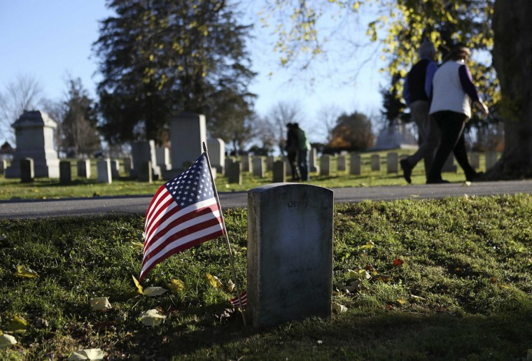 People walk past the headstone of Union Captain William Miller, a Medal of Honor winner, at the Gettysburg National Cemetery in Pennsylvania November 18, 2013. The site is the burial ground for Civil War Union soldiers, where U.S. President Abraham Lincoln travelled to in 1863 to deliver a few concluding remarks at a formal dedication. Tuesday marks the 150th anniversary of Lincoln's famous Gettysburg Address. (Gary Cameron/REUTERS)