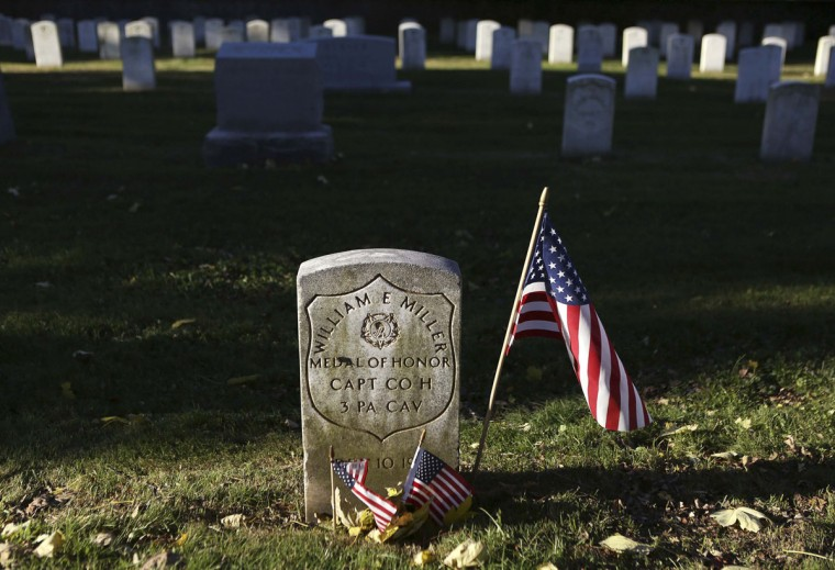 The headstone of Union Captain William Miller, a Medal of Honor winner, is seen at the Gettysburg National Cemetery in Pennsylvania November 18, 2013. The site is the burial ground for Civil War Union soldiers, where U.S. President Abraham Lincoln travelled to in 1863 to deliver a few concluding remarks at a formal dedication. Tuesday marks the 150th anniversary of Lincoln's famous Gettysburg Address. (Gary Cameron/REUTERS)