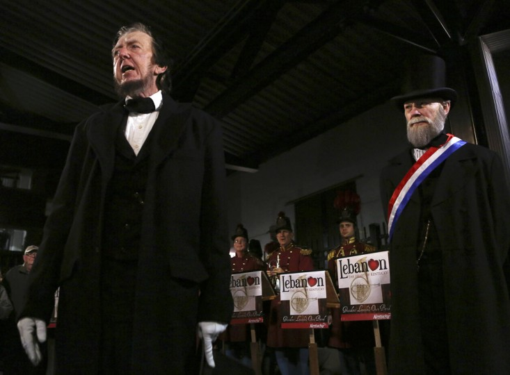 A re-enactor portraying former U.S. President Abraham Lincoln (L) is welcomed by another portraying David Wills, Lincoln's host in Gettysburg, at the Gettysburg, Pennsylvania train station November 18, 2013. Lincoln travelled to Gettysburg in 1863 to deliver a few concluding remarks, his Gettysburg Address, at a formal dedication of the Gettysburg National Cemetery. Wills' was Lincoln's host during the President's visit in 1863. (Gary Cameron/REUTERS)