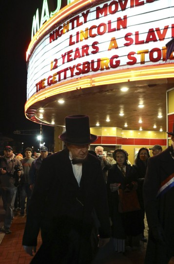 A re-enactor portraying former U.S. President Abraham Lincoln walks past a theater marquee in Gettysburg, Pennsylvania November 18, 2013. Lincoln travelled to Gettysburg in 1863 to deliver a few concluding remarks, his Gettysburg Address, at a formal dedication of the Gettysburg National Cemetery. Tomorrow marks the 150th anniversary of Lincoln's famous two-minute speech. (Gary Cameron/REUTERS)