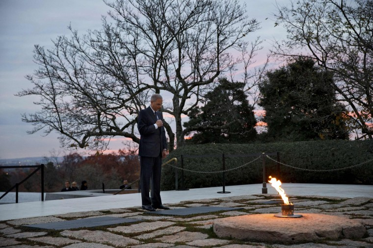 U.S. Attorney General Eric Holder pays his respects at the grave of U.S. President John F. Kennedy at Arlington National Cemetery in Arlington, Virginia, November 22, 2013. Friday marks the 50th anniversary of JFK's assassination. (Jacquelyn Martin/REUTERS)
