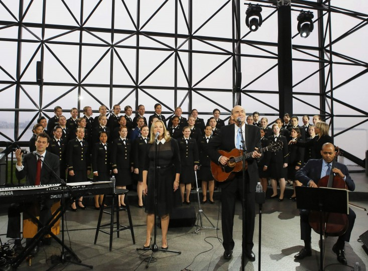 Musician James Taylor and the U.S. Naval Academy Women's Glee Club perform during a ceremony to commemorate the 50th anniversary of the assassination of President Kennedy at the John F. Kennedy Library and Museum in Boston, Massachusetts November 22, 2013. (Brian Snyder/REUTERS)
