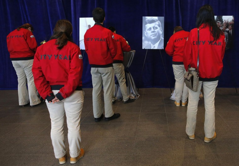 Participants from the NGO City Year line up to sign memory books at the John F. Kennedy Library and Museum in Boston, Massachusetts November 22, 2013, to commemorate the 50th anniversary of the assassination of President Kennedy November 22, 1963. (Brian Snyder/REUTERS)