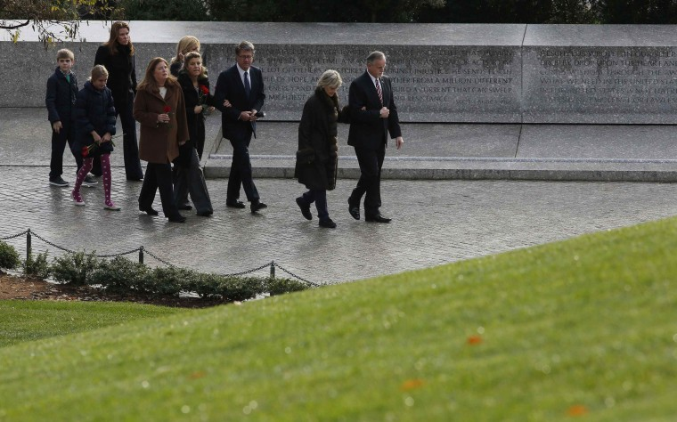 Members of the Kennedy family walk over to Robert and Edward Kennedy's gravesite to pay their respects at Arlington National Cemetery to mark the 50th anniversary of the assassination of former U.S. President John F. Kennedy at his gravesite in Arlington, November 22, 2013. (Larry Downing/REUTERS)