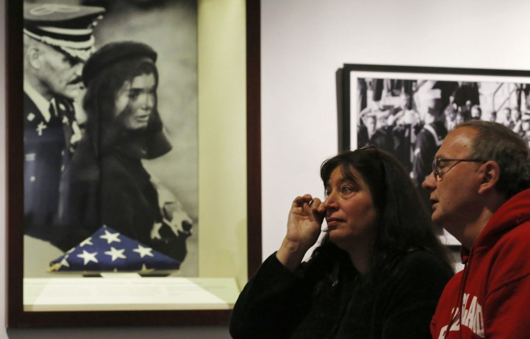 A visitor to the John F. Kennedy Library and Museum wipes away a tear while watching a video of the state funeral for President Kennedy at the museum in Boston, Massachusetts November 22, 2013, as part of a special exhibit to commemorate the 50th anniversary of the assassination of President Kennedy November 22, 1963. (Brian Snyder/REUTERS