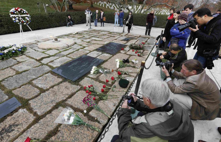 Visitors take pictures while they pay their respects at Arlington National Cemetery to mark the 50th anniversary of the assassination of former U.S. President John F. Kennedy at his gravesite in Arlington, November 22, 2013. (Larry Downing/REUTERS)