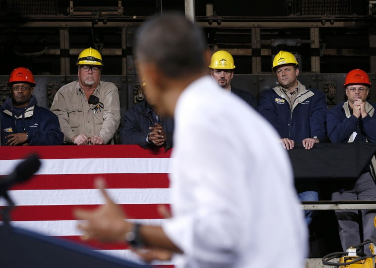 Workers listen as U.S. President Barack Obama speaks about the economy during a visit to ArcelorMittal steel mill in Cleveland, Ohio November 14, 2013. (REUTERS/Kevin Lamarque)