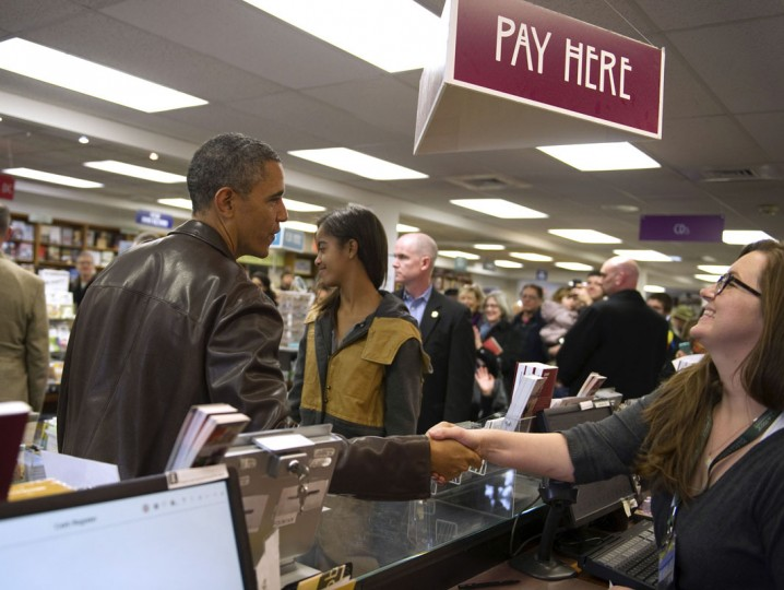 U.S. President Barack Obama shops with daughter Malia at Politics and Prose Bookstore and Coffeehouse in Washington, November 30, 2013. (REUTERS/Mary F. Calvert)