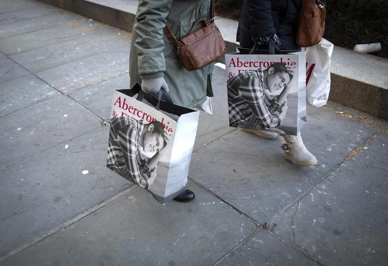 Shoppers walk down 5th Ave with their shopping bags during Black Friday Sales in New York November 29, 2013. Black Friday, the day following Thanksgiving Day holiday, has traditionally been the busiest shopping day in the United States. (Carlo Allegri/REUTERS)