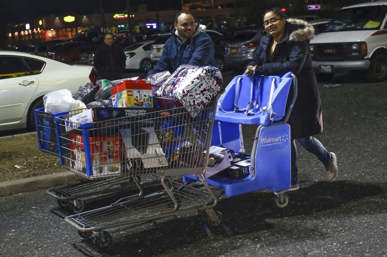 Shoppers walk with a cart full of purchases from Walmart in Westbury, New York, November 29, 2013. Black Friday, the day following Thanksgiving Day holiday, has traditionally been the busiest shopping day in the United States. (Shannon Stapleton/REUTERS)