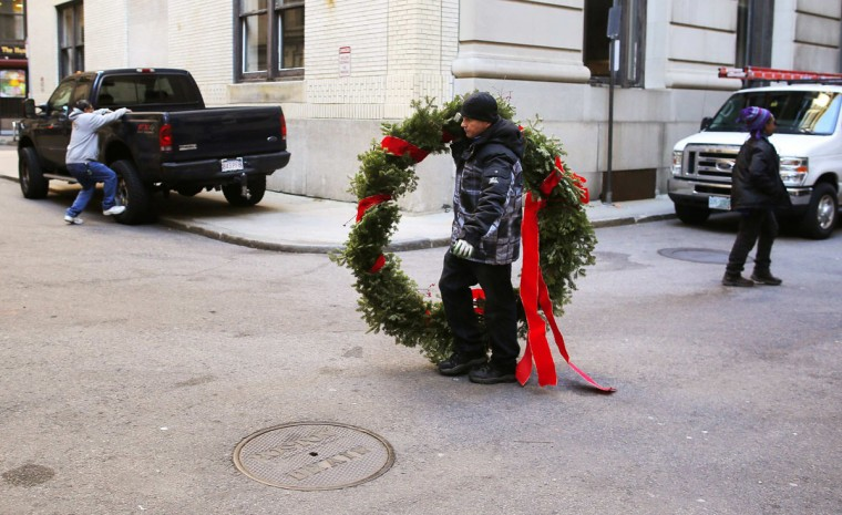 Osmin Tejada from Lotus Designs florist delivers a holiday wreath on Black Friday in Boston, Massachusetts November 29, 2013. Black Friday, the day following the Thanksgiving Day holiday, has traditionally been the busiest shopping day in the United States. (Brian Snyder/REUTERS)