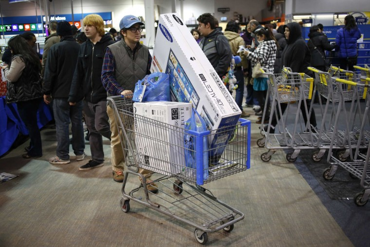 A shopper pushes a cart full of electronics at the Best Buy electronics store in Westbury, New York, November 29, 2013. Black Friday, the day following Thanksgiving Day holiday, has traditionally been the busiest shopping day in the United States. (Shannon Stapleton/REUTERS)