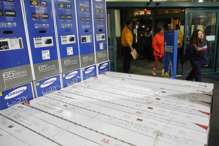 The first customers in line enter the Best Buy store when it opened at 1am in Cambridge, Massachusetts November 29, 2013. Black Friday, the day following the Thanksgiving Day holiday, has traditionally been the busiest shopping day in the United States. (Brian Snyder/REUTERS)