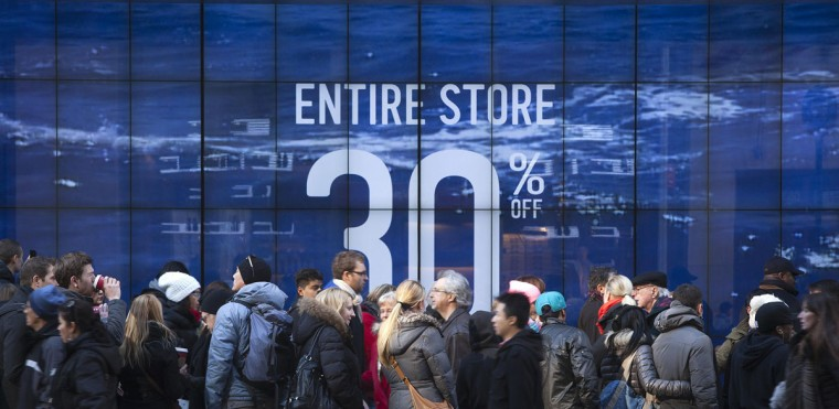 People line up to get into a store on 5th Ave. looking for Black Friday sales in New York November 29, 2013. Black Friday, the day following Thanksgiving Day holiday, has traditionally been the busiest shopping day in the United States. (Carlo Allegri/REUTERS)