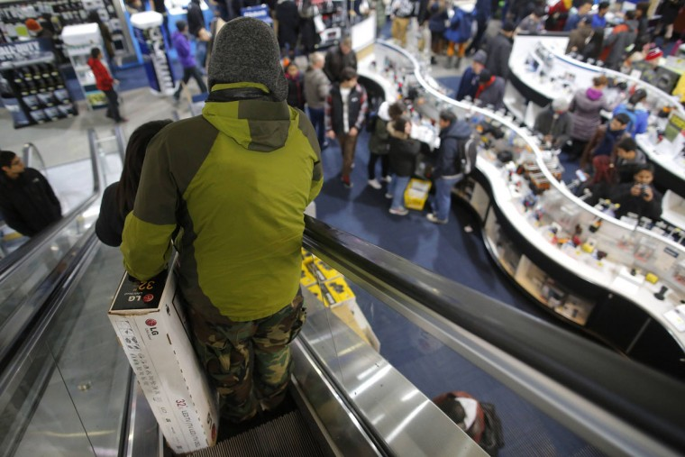 Customers shop at the Best Buy store, which opened at 1 a.m., in Cambridge, Massachusetts November 29, 2013. Black Friday, the day following the Thanksgiving Day holiday, has traditionally been the busiest shopping day in the United States. (Brian Snyder/REUTERS)