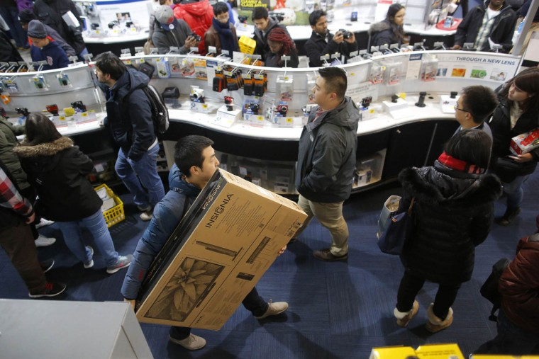 Customers shop at the Best Buy store, which opened at 1am, in Cambridge, Massachusetts November 29, 2013. Black Friday, the day following the Thanksgiving Day holiday, has traditionally been the busiest shopping day in the United States. (Brian Snyder/REUTERS)