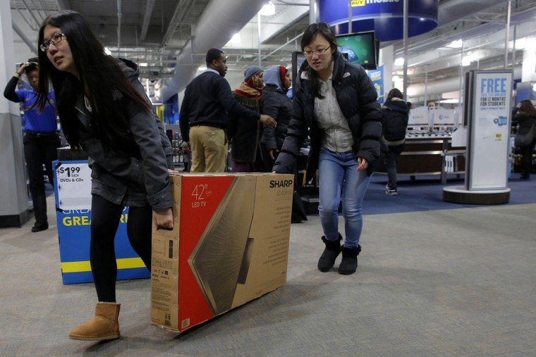 Two women slide their newly purchased television to the door at the Best Buy store, which opened at 1am, in Cambridge, Massachusetts November 29, 2013. Black Friday, the day following the Thanksgiving Day holiday, has traditionally been the busiest shopping day in the United States. (Brian Snyder/REUTERS)