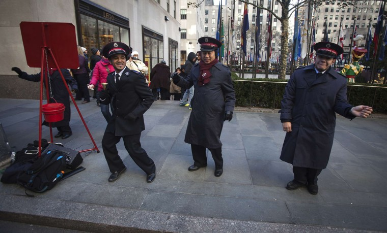 Salvation Army members sing and dance at Rockefeller Center during Black Friday Sales in New York November 29, 2013. Black Friday, the day following Thanksgiving Day holiday, has traditionally been the busiest shopping day in the United States. (Carlo Allegri/REUTERS)