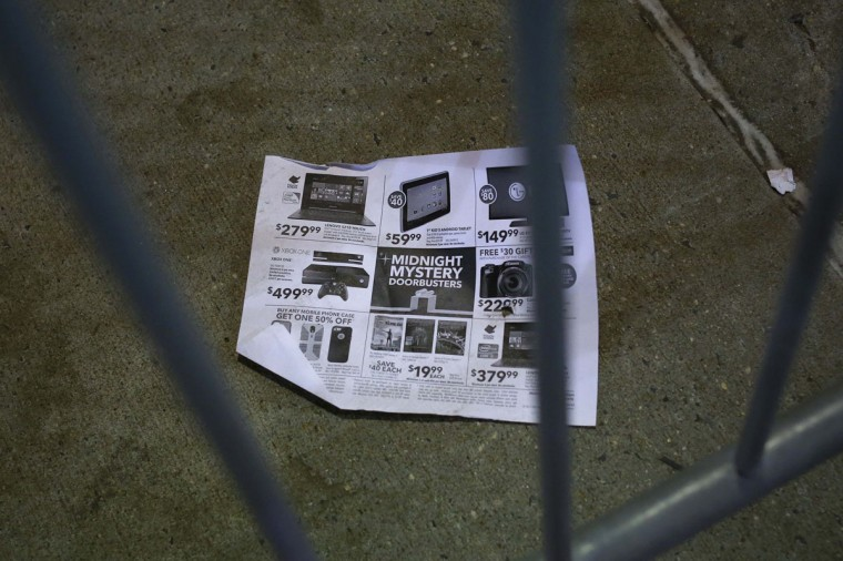 A Midnight Mystery Doorbuster flier is seen outside the Best Buy electronics store in Westbury, New York, November 29, 2013. Black Friday, the day following Thanksgiving Day holiday, has traditionally been the busiest shopping day in the United States. (Shannon Stapleton/REUTERS)