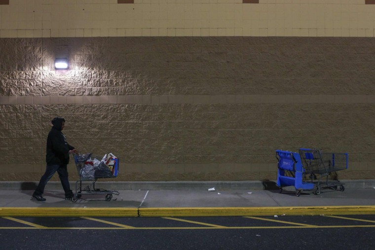 A shopper pushes a cart outside a WalMart store in Westbury, New York, November 29, 2013. Black Friday, the day following Thanksgiving Day holiday, has traditionally been the busiest shopping day in the United States. (Shannon Stapleton/REUTERS)