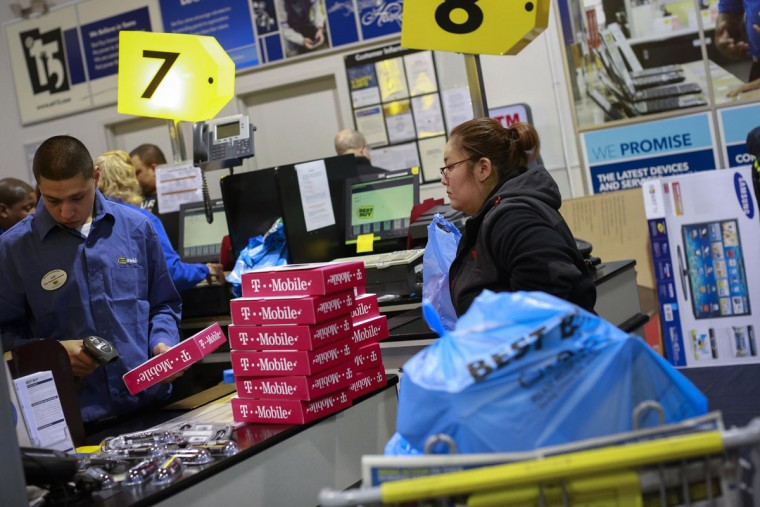 A shopper waits at the register to finish paying for electronics at the Best Buy electronics store in Westbury, New York, November 29, 2013. Black Friday, the day following Thanksgiving Day holiday, has traditionally been the busiest shopping day in the United States. (Shannon Stapleton/REUTERS)