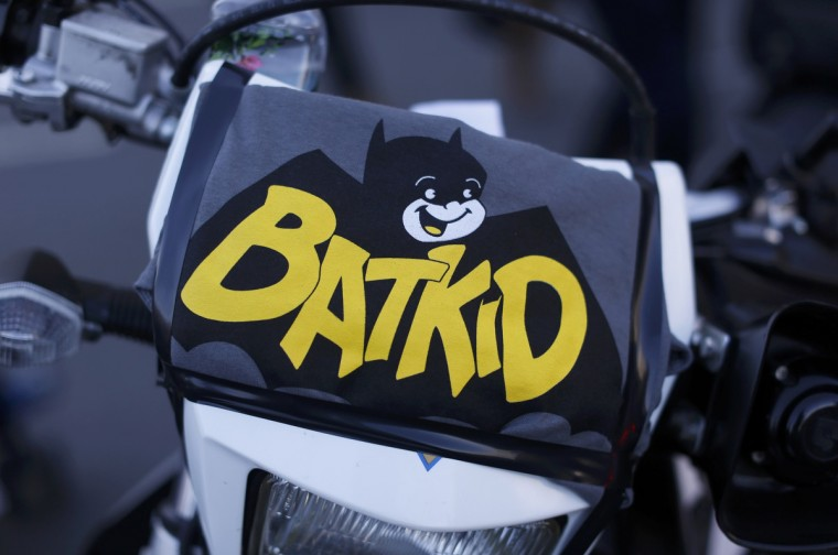 "A sign is seen on a police motorcycle used during a day of events for five-year-old leukemia survivor Miles Scott, aka ""Batkid"" at San Francisco City Hall during a ceremony arranged by the Make- A - Wish Foundation in San Francisco, California November 15, 2013. The young cancer survivor was treated to various super hero scenarios including receiving a commendation at San Francisco City Hall. (Stephen Lam/Reuters)"