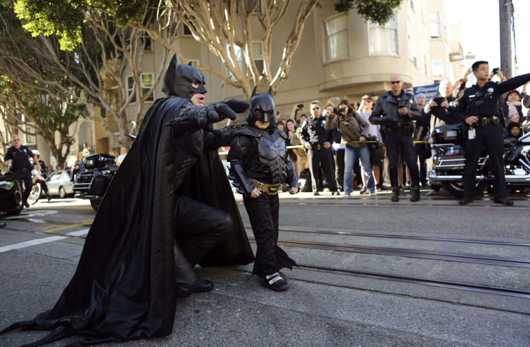 "Five-year-old leukemia survivor Miles, dressed as ""Batkid"", arrives with Batman to rescue a ""woman in distress"" as part of a day arranged by the Make-A-Wish Foundation in San Francisco, California November 15, 2013. The young cancer survivor will be treated to various super hero scenarios including receiving a commendation at San Francisco City Hall. (Robert Galbraith/REUTERS)"
