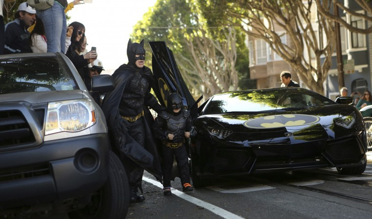 "Five-year-old leukemia survivor Miles dressed as ""Batkid"" arrives with a man dressed as Batman to rescue a woman in distress as part of a day arranged by the Make-A-Wish Foundation in San Francisco, California November 15, 2013. The young cancer survivor will be treated to various super hero scenarios including receiving a commendation at San Francisco City Hall. (Robert Galbraith/REUTERS)"