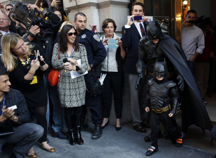 "Five-year-old leukemia survivor Miles dressed as ""Batkid"" and a man dressed as Batman leave a bank after they apprehended the ""Riddler"" as part of a day arranged by the Make-A-Wish Foundation in San Francisco, California November 15, 2013. The young cancer survivor will be treated to various super hero scenarios including receiving a commendation at San Francisco City Hall. (Stephen Lam/REUTERS)"