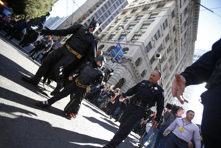 "Five-year-old leukemia survivor Miles dressed as ""Batkid"" and a man dressed as Batman are escorted by police officers back to their Batmobile after they apprehended the ""Riddler"" as part of a day arranged by the Make-A-Wish Foundation in San Francisco, California November 15, 2013. The young cancer survivor will be treated to various super hero scenarios including receiving a commendation at San Francisco City Hall. (Stephen Lam/REUTERS)"