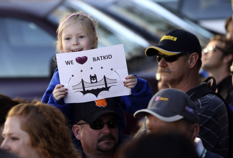 "Kayla Fry holds a sign as she waits to see five-year-old leukemia survivor Miles, aka ""Batkid"", as part of a day arranged by the Make-A-Wish Foundation in San Francisco, California November 15, 2013. Miles will be treated to various super hero scenarios including receiving a commendation at San Francisco City Hall. (Robert Galbraith/REUTERS)"