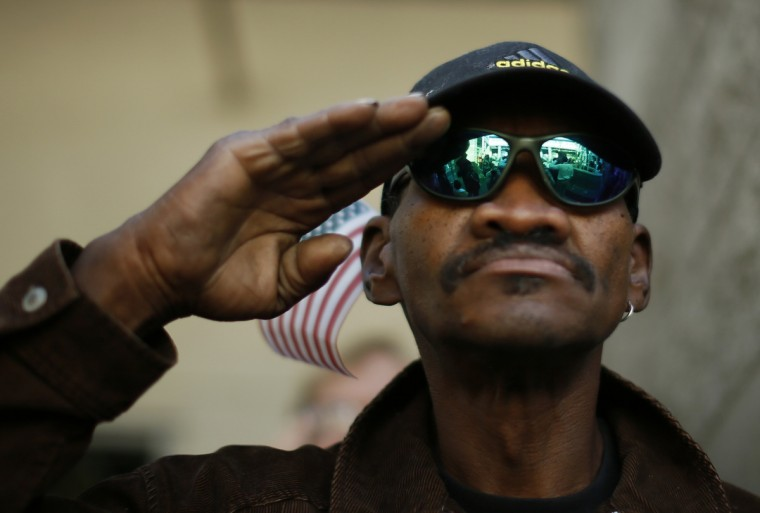 A veteran salutes the U.S. flag during a Veterans Day observance for homeless veterans at The Midnight Mission shelter on skid row in Los Angeles, California, November 11, 2013. There were 6,291 homeless veterans in Los Angeles County in 2013, according to the Los Angeles Homeless Services Authority. Many homeless veterans suffer from co-occurring disorders, including substance abuse, mental illness and post-traumatic stress disorder (PTSD), as well as chronic medical problems. (Lucy Nicholson/Reuters)