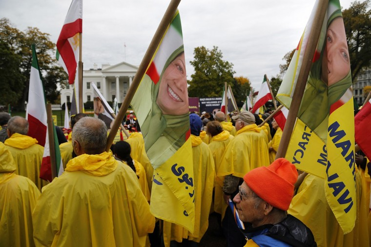 Supporters of Iranian opposition group Mujahedin-e Khalq (MEK) hold flags showing Maryam Rajavi, head of the National Council of Resistance of Iran (NCRI), as they rally against Iraq's Prime Minister Nuri al-Maliki hours before he is scheduled to meet with U.S. President Barack Obama, at the White House in Washington, November 1, 2013. The MEK fought on the side of former Iraqi leader Saddam Hussein during the 1980-88 Iran-Iraq war, mounting attacks on Iran from Iraq, and are calling for the U.S. to hold Iraqi leaders responsible for an attack on their Camp Ashraf settlement outside Baghdad in September 2013, in which 52 people were killed. The MEK blames the Iraqi army and special forces acting at Iran's behest for this attack, though the Iraqi government has said the accusation was baseless. The NCRI is affiliated to the MEK. (REUTERS/Jonathan Ernst)