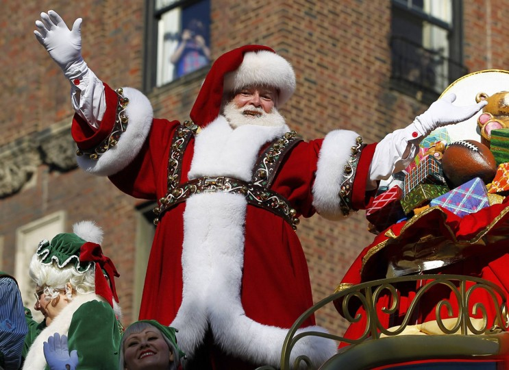 Santa Claus rides on his sleigh down Central Park West during the 86th Macy's Thanksgiving Day Parade in New York November 22, 2012. (Gary Hershorn/REUTERS)