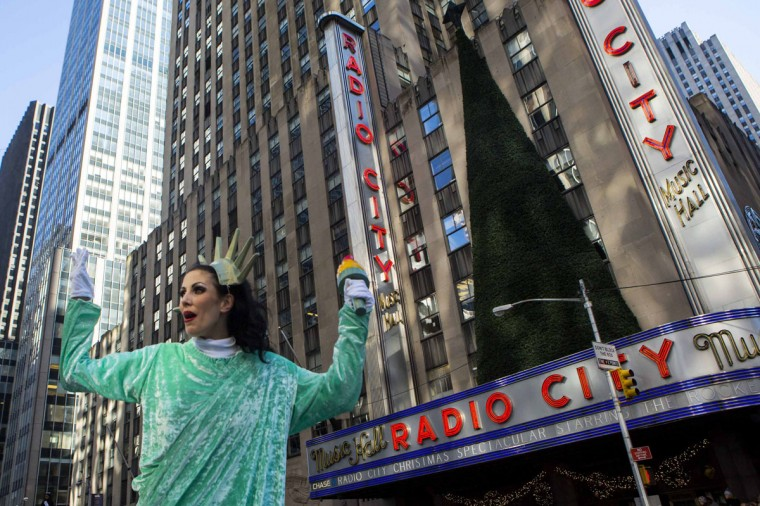 A participant gestures while walking down Sixth Avenue during the 87th Macy's Thanksgiving Day Parade in New York. (REUTERS/Eric Thayer)